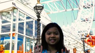 girl reviews the london eye ferris wheel