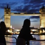 View of Tower Bridge from a Thames Clipper at night on River Thames London