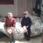 boys on bed at geffrye museum of the home london