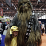 boy dressed as pikachoo next to Chewbacca at comic con KidRated