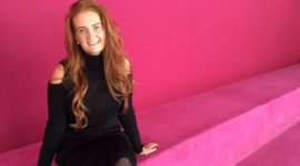 mummy blogger ginger mum amanda fulton poses in front of pink back ground