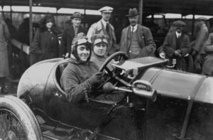 1920: MOTOR MEETING AT BROOKLANDS, WEYBRIDGE, SURREY. COMPETITOR IVY CUMMINGS AND HER MOTHER IN THEIR RACING CAR.